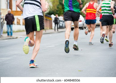 READING,UK-MARCH 19,2017:Group of colorful running feet and legs, some out of focus in the Vitality Reading half marathon competition. March 19, 2017 in Reading, Great Britain