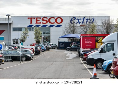 READING,UK-MARCH 23,2019:The Exterior and sign of a modern Tesco Extra supermarket.Tesco, is a British multinational groceries and general merchandise retailer