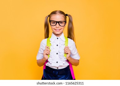 Ready back to school concept. Portrait of cute, nice, lovely, sweet blonde girl in formal wear look at camera isolated on yellow background