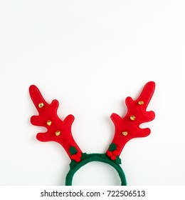 Ready background for your text Christmas card. Horn of a Christmas deer. Christmas decoration on hair