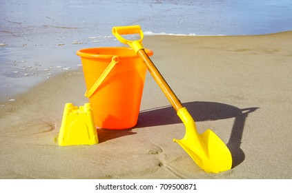 Ready to build a sandcastle with this shovel and pail on the beach