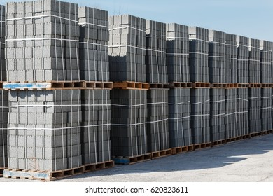 Ready concrete blocks in packing on wooden pallets