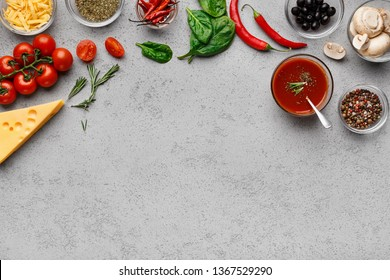 Ready for cooking. Ingredients and herbs for pizza, grey table with copy space