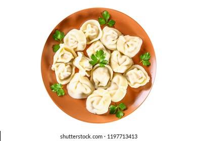 Ready dumplings. Dumplings isolated on white background. Boiled dumplings on a plate. Top view.