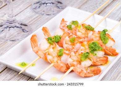 Ready to eat shrimps with green butter