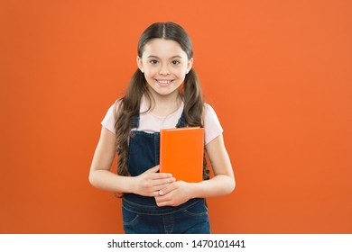Ready for first lesson. September is here. Back to school. Child hold book. Interesting literature. Development and education. Child care and happy childhood. Study at school. First day at school.