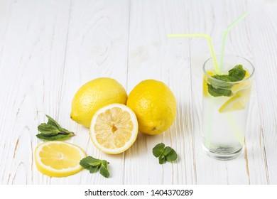 Ready fresh citrus mint drink and lemons