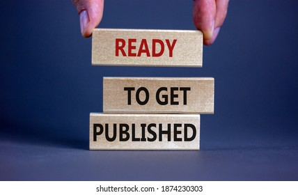 Ready to get published symbol. Wooden blocks with words 'ready to get published'. Male hand. Beautiful grey background. Copy space. Business and ready to get published concept.