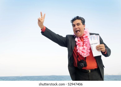 ready  for  a  holiday: businessman on the beach with air tickets