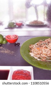 ready meal to eat tomato sauce green plate reflect in miror