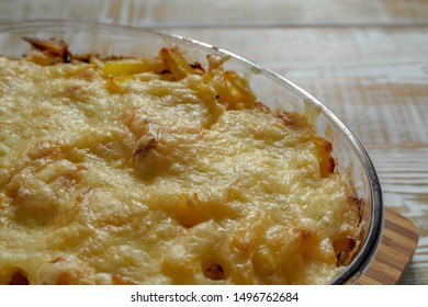 Ready meal - the Orlov-style meat. Closeup baked golden crust cheese in a transparent glass bowl.