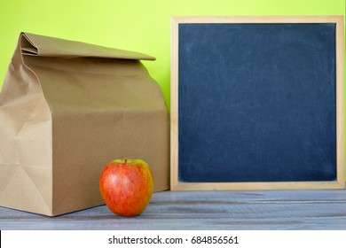 Ready packed lunch with blank blackboard ready for your menu text. Healthy food concept. Copy space