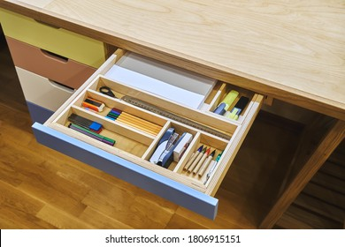 Ready for school. Open desk drawer with various school supplies arranged carefully in order before studies