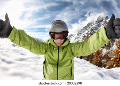 Ready for skiing. Portrait of young caucasian skier, on background a winter alpine landscape.