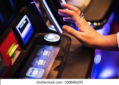Ready For Slot Machine Spin. Gambling in the Casino Concept. Caucasian Woman Playing Game.