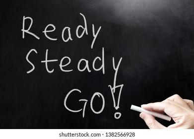 Ready, Steady, Go concept words written on blackboard