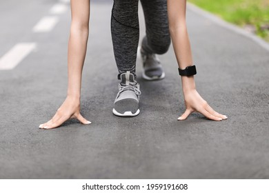 Ready, Steady, Go. Cropped Image Of Female Runner Standing In Starting Position On Path In Park, Ready For Jogging Outdoors, Closeup