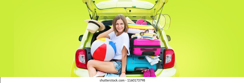 Ready to travel. Woman in Green Overloaded Car with Stuff Things before Trip. Bright Suitcases Luggage Full Stuff Accessories Clothes Ballon. Summer Concept Holiday Adventure Isolated on fuchsia color