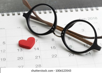 Ready for valentine's day concept with eyeglasses and red lovely heart shape on 14 Feb calendar.