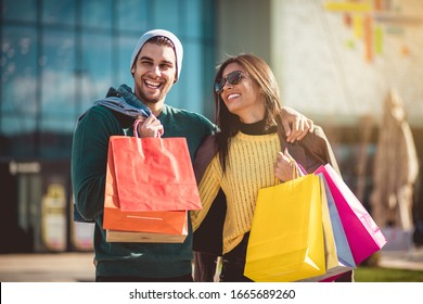 Ready for weekend. Young couple in shopping.