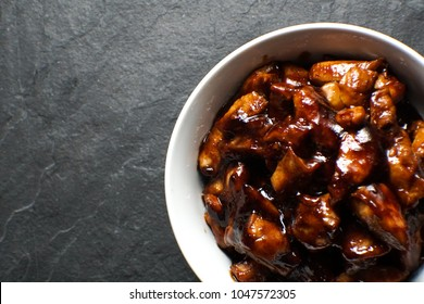 Ready-made chicken breast pieces in teriyaki sauce free space. Asian cuisine
