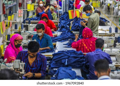 Readymade garments workers work in a factory during a coronavirus pandemic in Gazipur on May 2, 2021.