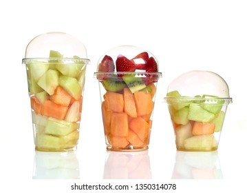 ready-to-eat fruit in plastic container on white background