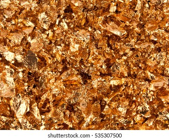 Real 24k gold flakes background