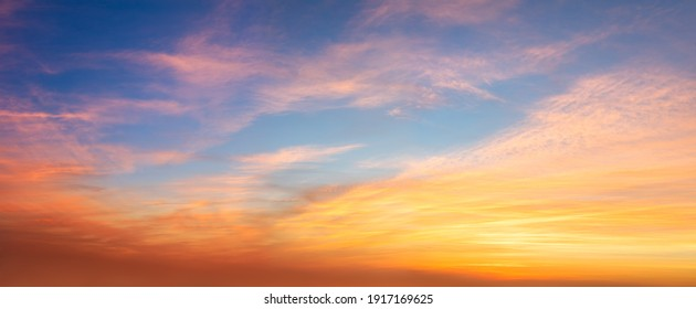 Real amazing panoramic sunrise or sunset sky with gentle colorful clouds. Long panorama, crop it