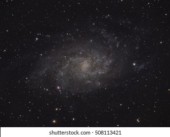 Real astronomic picture taken with telescope of triangulum galaxy, a big spiral galaxy