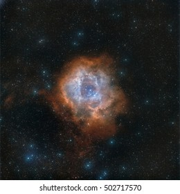 Real astronomical picture taken with telescope of Rosette nebula in narrowband, following hubble palette. This is an object that can be seen in winter, very close to orion constellation