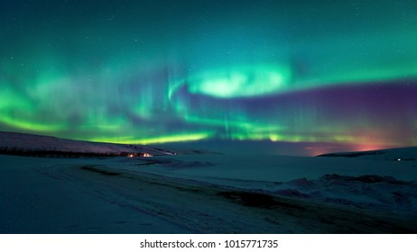 real aurora borealis wave in the sky background in the winter night