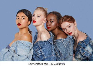 The real beauty exists in every corner of the world and is presented by women of all races. Four beautiful ladies in denim shirts and with different skin and hair colour are posing in a row.