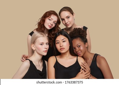 The real beauty exists in every corner of the world and is presented by women of all races. Group portrait of five beautiful ladies in black tops and with different skin and hair colour.