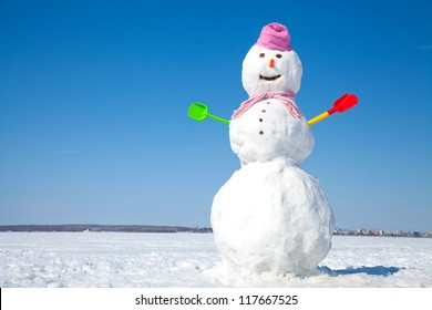 Real big snowman blue sky background