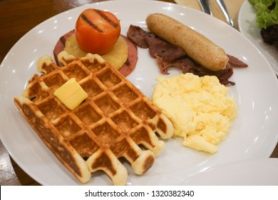real breakfast with wafle, sausage, egg, bacon and fresh tomato
