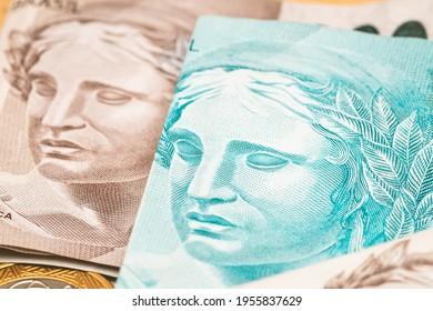Real - Brl, money from Brazil. Dinheiro, Reais, Real Brasileiro, Brasil. Folded money notes of the Brazilian Real in macro photography.