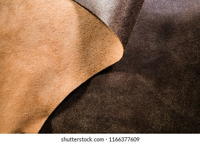 Real brown leather fabric folded over in a wave.