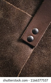Real brown leather - a strap attached to fabric.