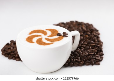 Real capuccino decorated with coffee beans