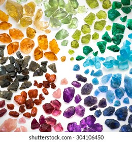 Real colorful gemstones background. Square shaped image with blurred and darkened edges.