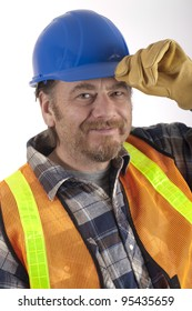 real construction worker with hard hat and safety vest smiling