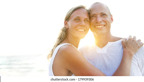 Real Couple on Beach at Sunset