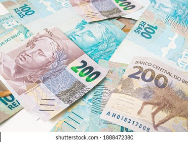 Real currency ( BRL ), money from Brazil. Dinheiro, Reais, Real Brasileiro, Brasil. A group of brazilian banknotes in close up.