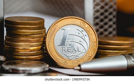 Real Currency, Money from Brazil. Coin, Reais, Real, Brasil. A group of Brazilian coins on a wood object. Close-up photo. Finance and Brazilian economy concepts.