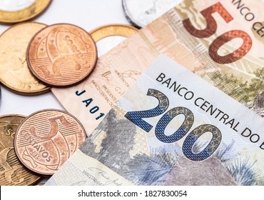 Real currency. Money from Brazil. Dinheiro, Brasil, Reais, Real Brasileiro. Banknotes and coins on a white surface.