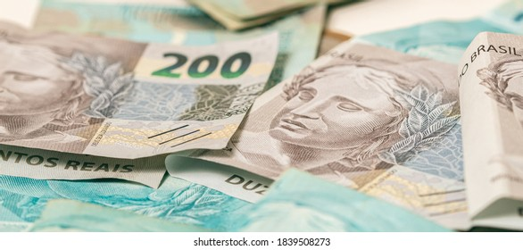 Real currency, money from Brazil. Dinheiro, Real Brasileiro, Reais, Brasil. Brazilian banknotes of 200 reais in close up.