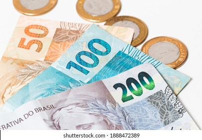 Real currency, money from Brazil. Dinheiro, Reais, Real Brasileiro, Brasil. A group of brazilian banknotes in close up.