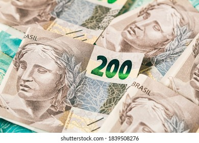 Real currency, money from Brazil. Reais, Real Brasileiro, Dinheiro, Brasil. A group of Brazilian banknotes of 200 reais in close up.