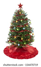 Real decorated Christmas tree with skirt, garland, ornaments and star isolated on white